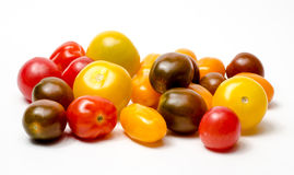 Cherry tomatoes. Organic colorful cherry tomatoes on white Stock Photography