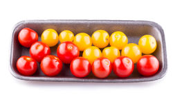 Cherry tomatoes. Packaged for sale. white background Stock Photos