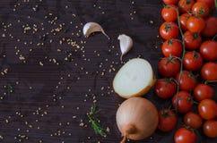 Cherry Tomatoes para conservar com alho Fotos de Stock Royalty Free