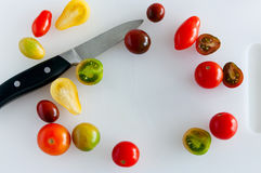 Cherry tomatoes and paring knife Stock Photos