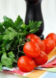 Cherry tomatoes and parsley and black pepper Royalty Free Stock Images