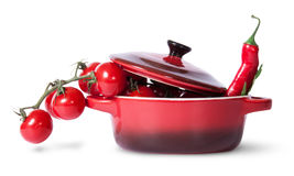 Cherry tomatoes with parsley and chili in saucepan Stock Images