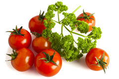 Cherry tomatoes and parsley on white. Royalty Free Stock Photos