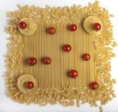 Cherry tomatoes on pasta. Stock Photography