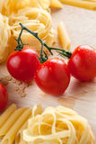 Cherry tomatoes and pasta Stock Photos