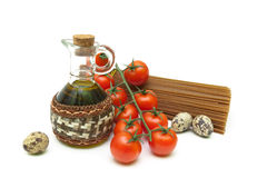 Cherry tomatoes, pasta, quail eggs and olive oil on a white back Stock Photo