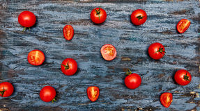 Cherry tomatoes pattern. Dark wood background. Top view. Flat lay. Organic food Stock Photos
