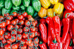 Cherry tomatoes and peppers beautifully situated on a farmer`s m Royalty Free Stock Photography