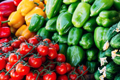 Cherry tomatoes and peppers beautifully situated on a farmer`s market Stock Image