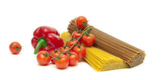 Cherry tomatoes, peppers and pasta isolated on white background Royalty Free Stock Photos