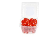 Cherry tomatoes in a plastic container Stock Photo