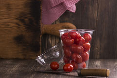 Cherry tomatoes in a plastic container Stock Image