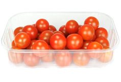 Cherry tomatoes in a plastic container Royalty Free Stock Photos