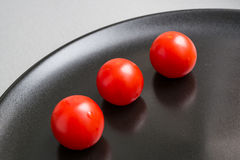 Cherry tomatoes on plate Stock Image