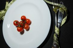 Cherry tomatoes on the plate royalty free stock photography