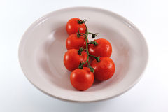 Cherry tomatoes on plate Royalty Free Stock Image