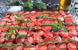 Cherry tomatoes prepared with jerk spices and olive oil Royalty Free Stock Images