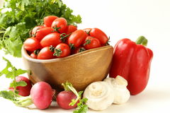 Cherry tomatoes, radishes, peppers and parsley Stock Photos