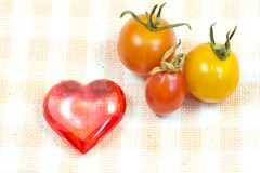 Cherry tomatoes and red heart Royalty Free Stock Image