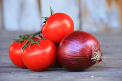 Cherry tomatoes and red onion on table Stock Image