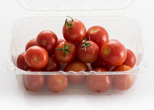 Cherry tomatoes in retail packaging. On a white background stock photography
