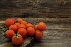 Cherry tomatoes on a rustic background Stock Photography