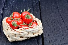 Cherry tomatoes in a rustic wicker Stock Image