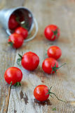 Cherry tomatoes. On rustic wooden background Royalty Free Stock Photography