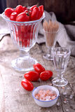 Cherry tomatoes with sea salt Royalty Free Stock Image
