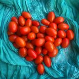 Cherry tomatoes in shape of heart Royalty Free Stock Images