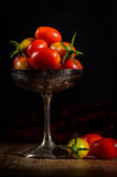Cherry tomatoes in a silver cup in dark food style photography Royalty Free Stock Images
