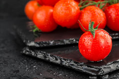 Cherry tomatoes on slate backgound Royalty Free Stock Photos