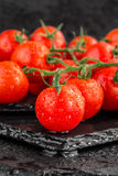 Cherry tomatoes on slate backgound Royalty Free Stock Images