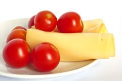 Cherry tomatoes with sliced cheese Stock Image