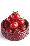 Cherry tomatoes in the small basket Royalty Free Stock Images