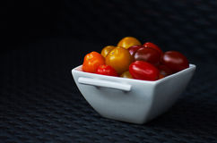 Cherry Tomatoes. A small bowl of ripe cherry tomatoes royalty free stock photo
