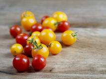 Cherry tomatoes some softfocus. On wood background Royalty Free Stock Image