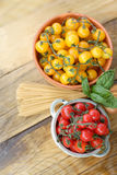 Cherry tomatoes and spaghetti Stock Image