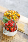 Cherry tomatoes and spaghetti on the table Royalty Free Stock Photo