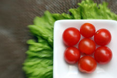 Cherry tomatoes in a square white bowl Stock Photography