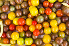 Cherry tomatoes - Stock Image. Organically grown red cherry tomatoes background Stock Photo