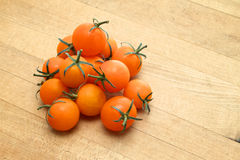 Cherry tomatoes. Sunburst cherry tomatoes on cutting board Stock Images