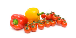 Cherry tomatoes and sweet peppers isolated on white background Stock Photography