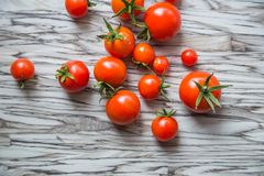 Cherry tomatoes on a table, vegetables from a kitchen garden. top view. Cherry tomatoes on a table Stock Photos