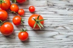 Cherry tomatoes on a table, vegetables from a kitchen garden. top view. Cherry tomatoes on a table Stock Photo