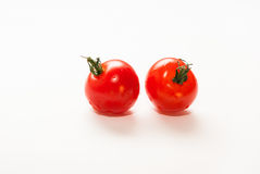 Cherry tomatoes with tails Royalty Free Stock Images