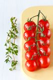 Cherry tomatoes and thyme. Stock Photo