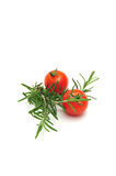 Cherry Tomatoes and Thyme. Two Cherry Tomatoes and Thyme branches on a light colored background Royalty Free Stock Image