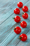 Cherry tomatoes on a turquoise surface Royalty Free Stock Photos
