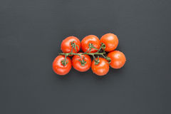 Cherry tomatoes with water droplets Stock Images